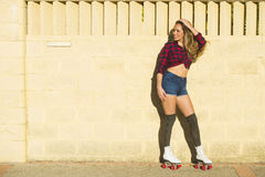 Young woman in roller skates Stock Images