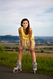 Young woman on rollerblades Stock Image