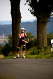 Young woman on rollerblades Royalty Free Stock Images
