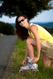 Young woman on rollerblades in the country Royalty Free Stock Photos