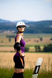 Young woman on rollerblades in the country Stock Images