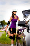 Young woman on rollerblades in the country Stock Photography