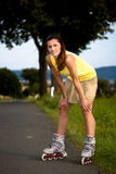 Young woman on rollerblades in the country Stock Photos
