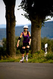 Young woman on rollerblades in the country Royalty Free Stock Images