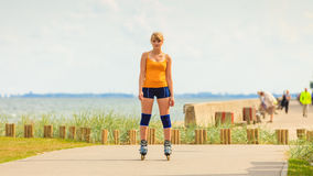 Young woman rollerblading outdoor on sunny day Royalty Free Stock Image