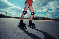 Young woman rollerblading on sunny day Stock Photography