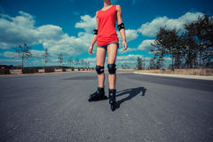 Young woman rollerblading on sunny day Stock Photo