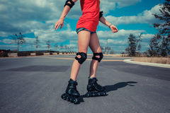 Young woman rollerblading on sunny day Royalty Free Stock Image