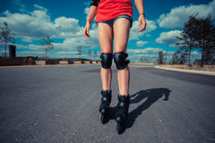 Young woman rollerblading on sunny day Stock Photos