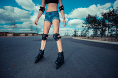 Young woman rollerblading on sunny day Royalty Free Stock Photo