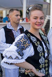 Young woman from Romania in traditional costume 16. ROMANIA, TIMISOARA - JULY 7, 2016: Young woman from Romania in traditional costume, present at the royalty free stock photography