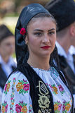 Young woman from Romania in traditional costume 11. ROMANIA, TIMISOARA - JULY 7, 2016: Young woman from Romania in traditional costume, present at the royalty free stock photography