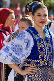 Young woman from Romania in traditional costume 20. ROMANIA, TIMISOARA - JULY 7, 2016: Young Romanian dancer in traditional costume, present at the international stock image