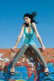 Young woman on roof Stock Photo