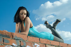 Young woman on roof Royalty Free Stock Images