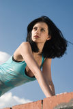 Young woman on roof Stock Images