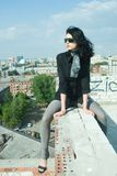 Young woman on roof Stock Image