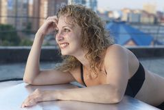 Young woman on roof Stock Photography