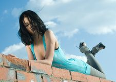 Young woman on roof Stock Photos