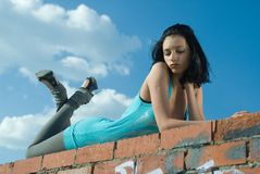 Young woman on roof Royalty Free Stock Image