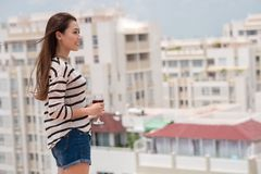 Young woman on the roof Stock Photography