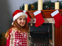 Young woman in the room with Christmas decorations Stock Photos