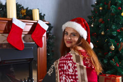 Young woman in the room with Christmas decorations Stock Image