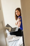 Young woman in a room with laptop Royalty Free Stock Photos