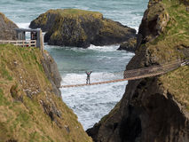 Young woman on rope bridge Ireland stock images