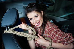 Young woman with rope inside New car Royalty Free Stock Photography
