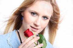 Young woman with rose Stock Images