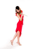 Young woman with a rose. Young woman in a dance like pose wit a rose in her hand Royalty Free Stock Images