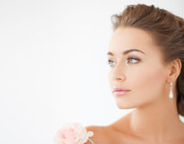 Young woman with rose flower Stock Photos