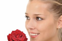Young woman with rose full of water drops Stock Photography