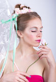 Young woman with rose, marshmallow makeup style, beauty fantasy. Royalty Free Stock Image