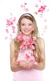 Young woman in rose petals Royalty Free Stock Images