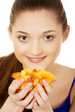 Young woman with rose petals. Beautiful teenage woman holding rose petals Royalty Free Stock Image