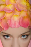 Young woman with rose petals on the head Stock Image