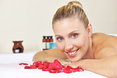Young woman with rose petals Stock Photography
