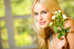 Young woman with roses Royalty Free Stock Photography