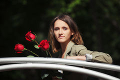 Happy young fashion woman with red roses stock photo