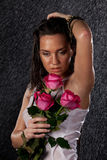 Young woman with roses under rain. Royalty Free Stock Photography