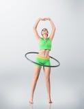 Young woman rotating hula hoop Stock Photography