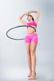 Young woman rotating hula hoop Stock Photos
