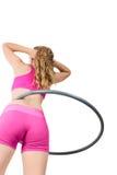 Young woman rotating hula hoop Stock Photo