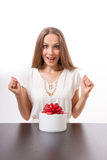 Young woman and round gift box on the table Stock Photography