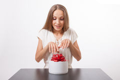 Young woman and round gift box on the table Royalty Free Stock Photos