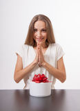 Young woman and round gift box on the table Royalty Free Stock Photo