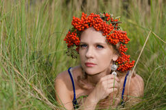 Young woman with rowan crown Stock Images