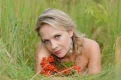 Young woman with rowan. (sorbus, mountain ash Royalty Free Stock Photos